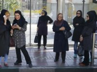 Iran women at a bus stop