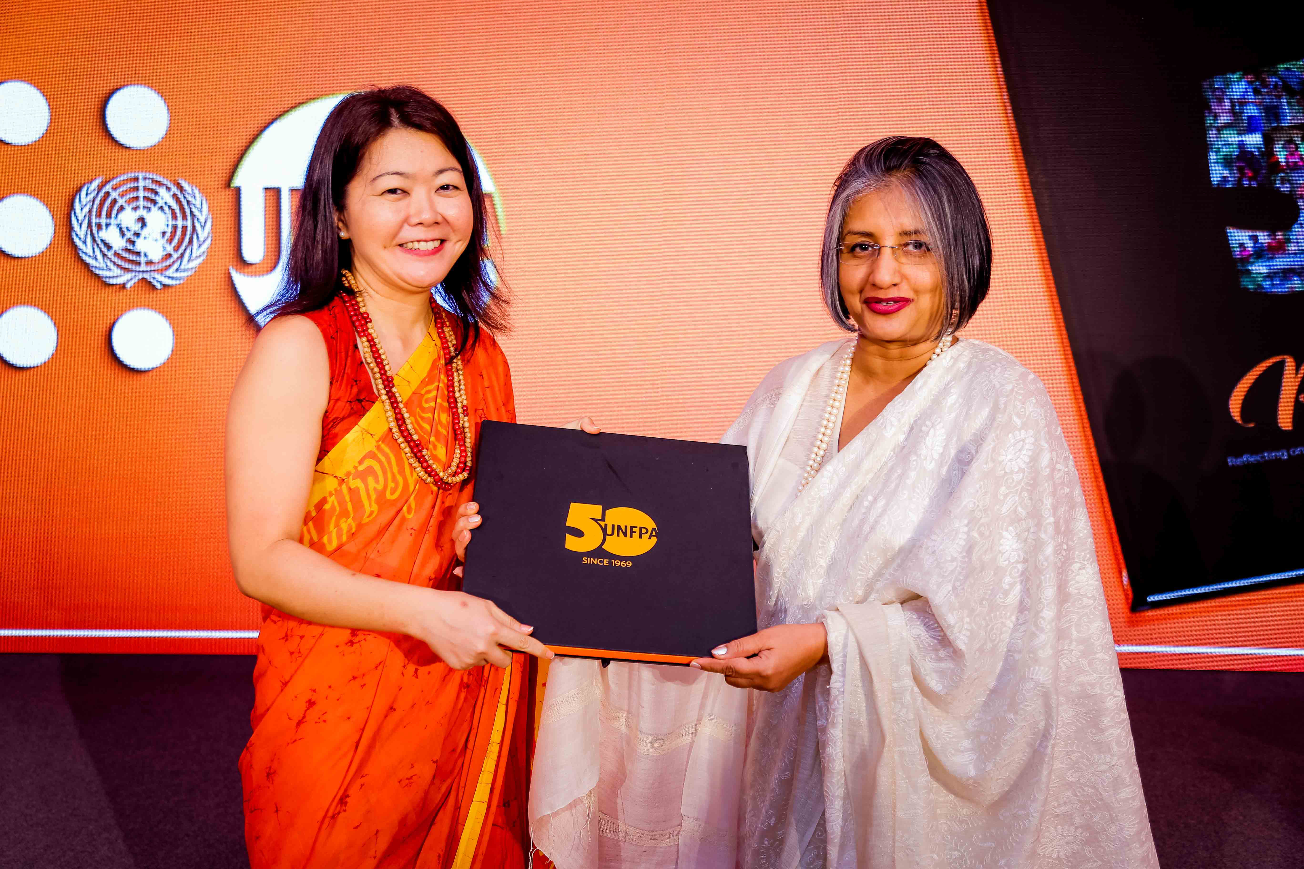Ms. Ritsu Nacken handing over the first copy of 'Perspectives' to Prof. Maithree Wickramasinghe