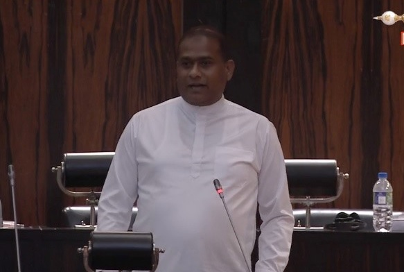 Premalal Jayasekara addressing parliament after coming from the death row